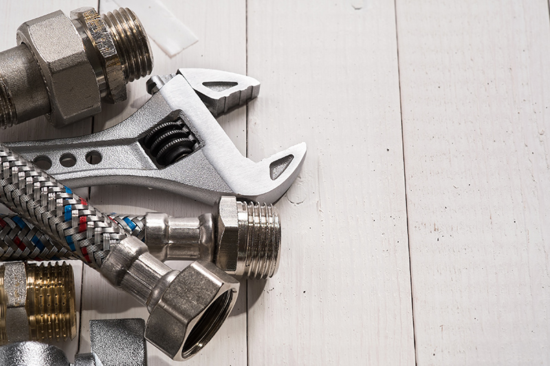 Plumbing tools for connecting water taps. Background